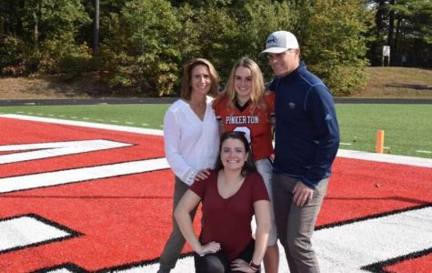 Not where she thought she would be, Annabel Veale ('21) stands with her family on senior night.